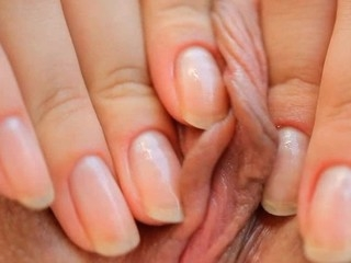 Beauty takes vibrator and pushes it in her ambrosial devoted fissure