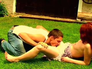 Filthy redhead whore is fucking respecting her partner on the grass