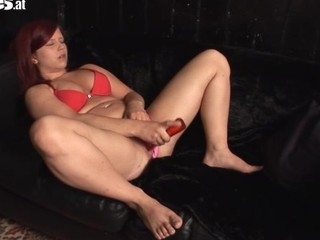 Cute Cora copulates her large peppery sex toy to climax