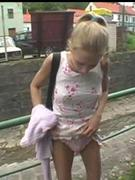 Wideness in foreign lands flashing her wet pussy