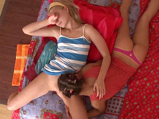 Two hot perky titted lesbian teens kissing each other